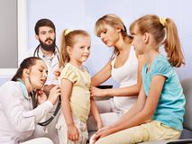 Child with doctor at exam. stock photo