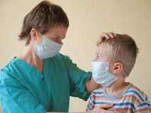 Child and doctor in mask. Child and medical doctor in mask Stock Photo