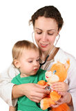 Child doctor toy. Child doctor with toy animal Stock Images