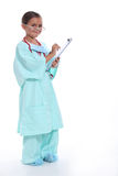 Child in a doctors scrubs Stock Photo