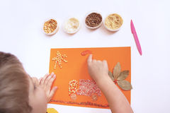 Child does applique. Royalty Free Stock Photography