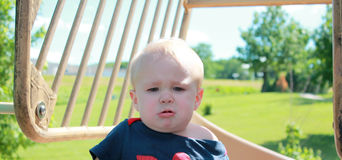 Child does not enjoy the playground Stock Photography
