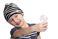 Child does not like the incandescent lamp Stock Photography
