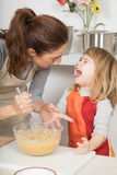 Child does not like whipped cream mother is making Royalty Free Stock Photos