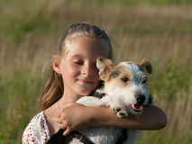 Child with dog. Child has a dog on his arm Royalty Free Stock Photos