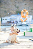 Child with dog. Happy babyboy with him dog on berth in summer Stock Photography