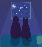 Child and dog look at the night sky Stock Image