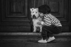 Child with dog. Child lovingly embraces his pet dog Royalty Free Stock Images