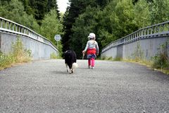 Child and dog for a walk. Stock Photos