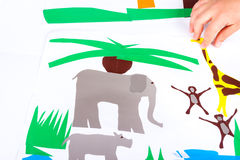 Child doing cutouts. View on hands Royalty Free Stock Photos