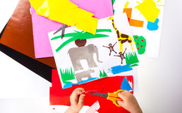 Child doing cutouts. View on hands Stock Images