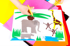 Child doing cutouts. View on hands Royalty Free Stock Images