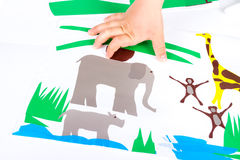 Child doing cutouts. View on hands Stock Image