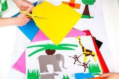 Child doing cutouts Stock Photos