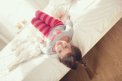 Free Child Doing Exercises While Lying In Bed Stock Photo - 68484030