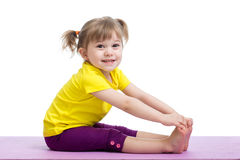 Child doing fitness exercises Stock Images