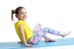 Child doing fitness exercises Stock Photography