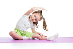 Child doing fitness exercises Royalty Free Stock Photos