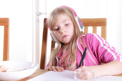Child doing her homework Royalty Free Stock Photos