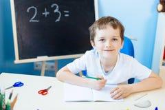 Child doing his homework Stock Photography