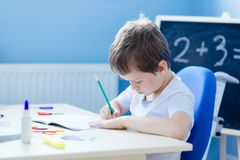 Child doing his homework Royalty Free Stock Image