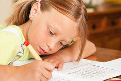Child doing homework Stock Images