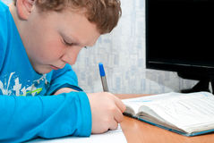 Child doing homework. Boy doing homework on mathematics in the room Royalty Free Stock Images