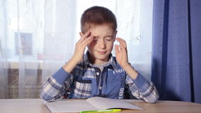 Child doing homework headache, tired boy to do the stock video
