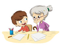Child doing homework with his grandmother Royalty Free Stock Photos