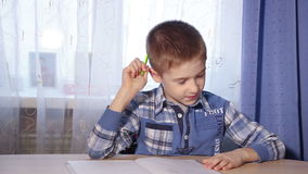 The child is doing homework, to do the job, motion stock footage