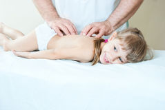 The child is doing massage Royalty Free Stock Photo