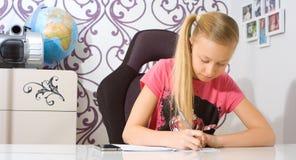 Child doing math homework Stock Images