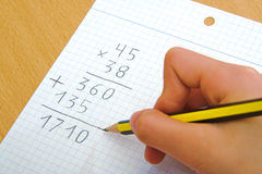 Child doing a math multiplication at school. Royalty Free Stock Photo