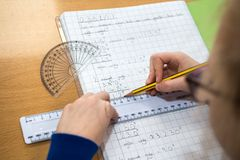 Child doing maths royalty free stock photography
