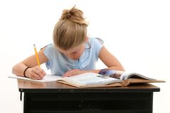 Child Doing School Work At Desk. Shot in studio over white Royalty Free Stock Photo