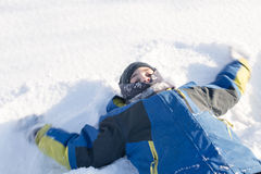 Child Doing the Snow Angel Stock Image
