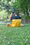 Child doing somersaults. On the lawn Stock Photo