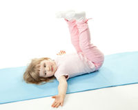Child doing sport exercises Royalty Free Stock Photos