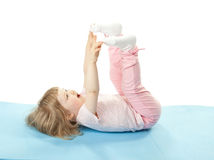 Child doing sport exercises Royalty Free Stock Image