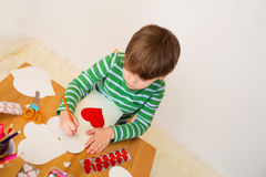 Child doing Valentine's Day Crafts: Hearts and Love Royalty Free Stock Photos