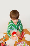Child doing Valentine's Day Crafts, Love and Hearts Royalty Free Stock Image