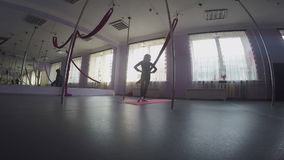 Child doing warm-up ankle exercises at dance class. Young elementary girl  doing warm-up exercises at dance class warming up her ankles stock footage