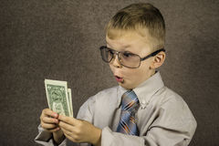 Child and dollars Stock Photos