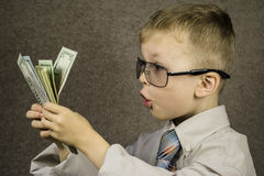 Child and dollars Stock Images