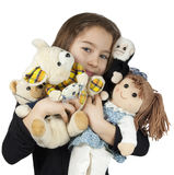 Child with dolls. A child with teddy bear and other dolls isolated on white background Royalty Free Stock Photos