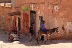 Child on a donkey Stock Photo