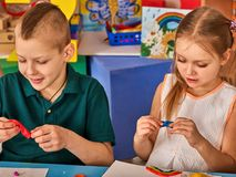 Child dough play in school. Plasticine for children. royalty free stock image