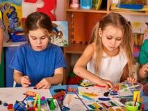 Child dough play in school. Plasticine for children. stock image