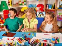 Child dough play in school. Plasticine for children. stock images