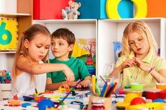 Child dough play in school. Plasticine for children. stock photo